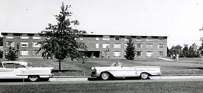 Front view from the Campus Mall of Gee Residence Hall in the early 1960s.
