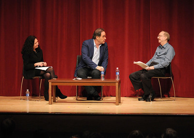 """Stone answered questions from the audience, as well as Dr. Cynthia Lucia, left, and Cineaste magazine's editor-in-chief, Gary Crowdus, right. Reflecting on his research of the assassination, he said, """"This is not me making up history. This is history."""""""