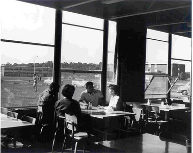 Students enjoying good conversation and good food in Daly Dining Hall in the late 1960s.