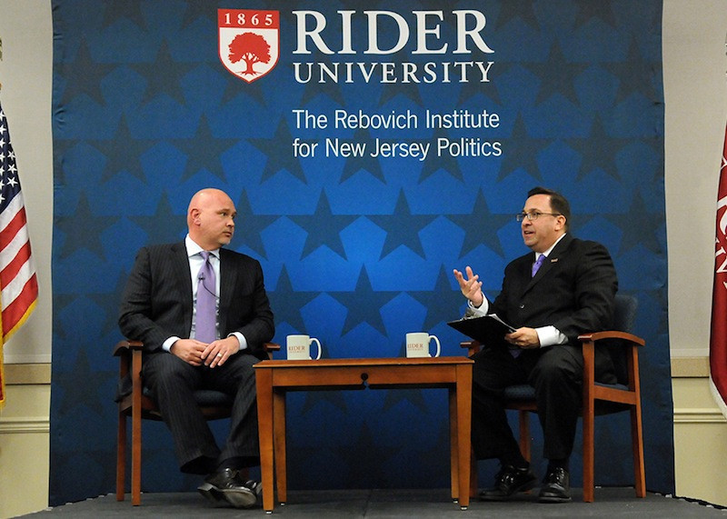 Since 2008, Ben Dworkin, right, has led the Rebovich Institute. Already known as one of New Jersey's most insightful political analysts, national reporters sought him out to discuss the potential Christie-for-President campaign. Here he talks to Steve Schmidt, senior advisor to the 2008 McCain for President campaign, on Nov. 12, 2013, at Rider.